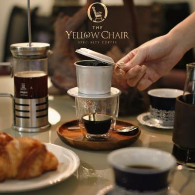 Drinking coffee at The Yellow Chair